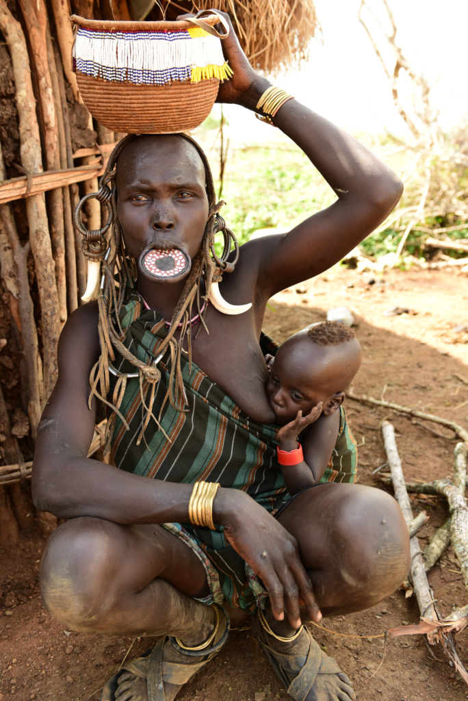 Mursi tribe Childre Photograph by Gilad Flesch